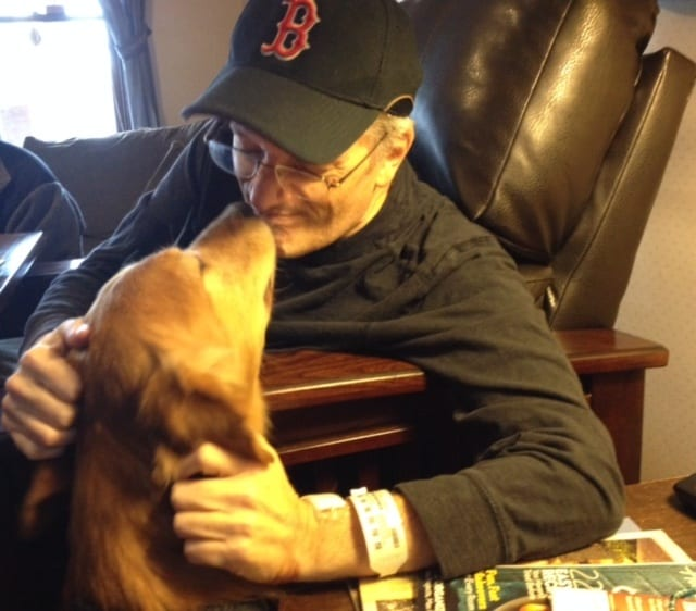 Let's WOOF about two touching photos of a golden retriever giving and receiving love.